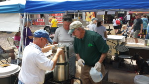 Curt, Theo and Paul cooking hotdogs at Oktoberfest